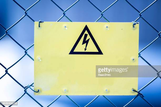 close-up of warning sign on chainlink fence - wire mesh fence stock pictures, royalty-free photos & images