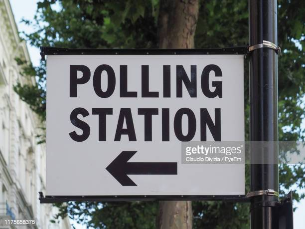 close-up of warning sign on road - polling station stock pictures, royalty-free photos & images
