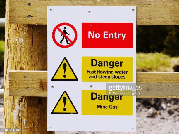 close-up of warning sign outdoors - road sign board stock pictures, royalty-free photos & images