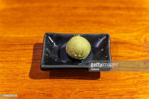 close-up of wasabi ball on wooden table - wasabi stock pictures, royalty-free photos & images