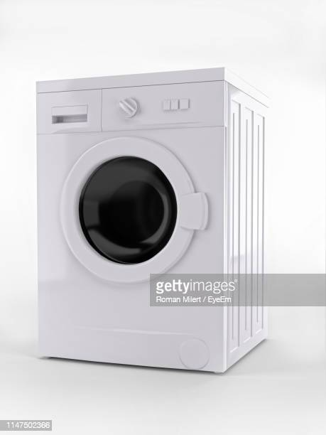 close-up of washing machine against white background - washing machine stock pictures, royalty-free photos & images