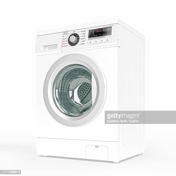 close-up of washing machine over white background - washing machine stock pictures, royalty-free photos & images