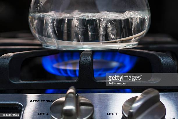 close-up of water boiling on gas burner - boiling stock pictures, royalty-free photos & images