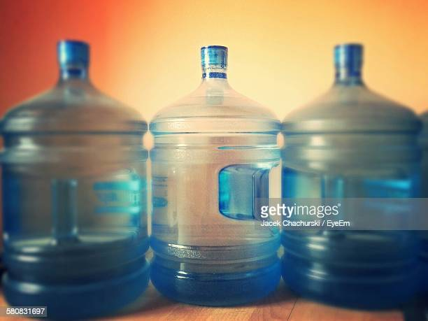 Close-Up Of Water Bottles On Table