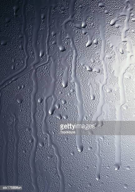 close-up of water dripping down a gray surface