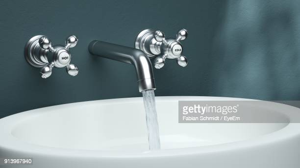 close-up of water dripping from faucet in sink - lavandino foto e immagini stock