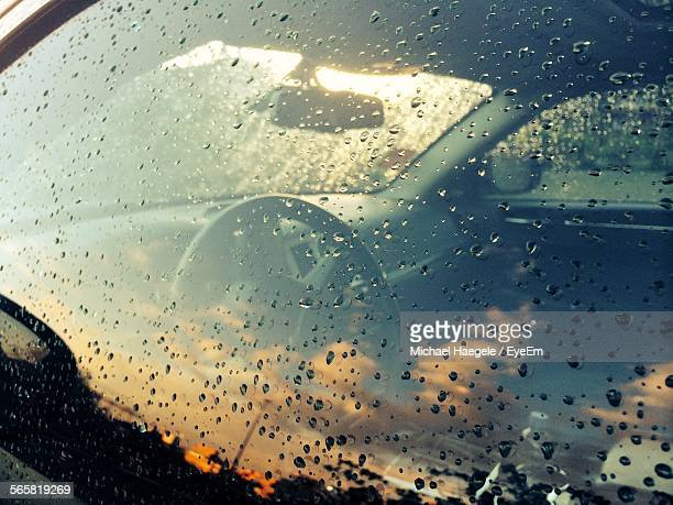 Close-Up Of Water Drops On Car Window
