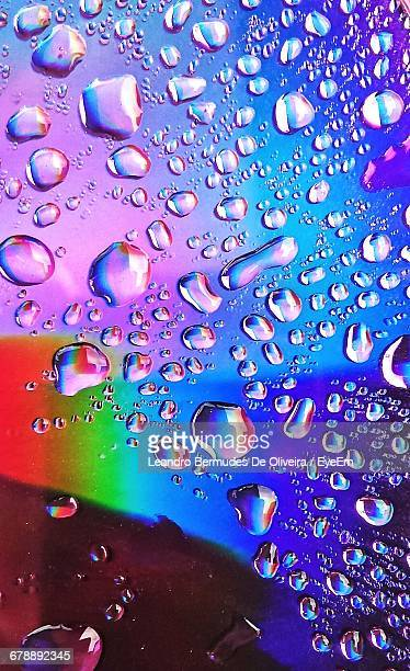 Close-Up Of Water Drops On Compact Disc