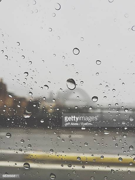 close-up of water drops on glass - sydney rain stock pictures, royalty-free photos & images