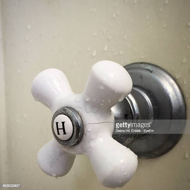 Close-Up Of Water Drops On White Valve In Bathroom