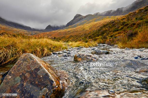 close-up of water flowing, mountain stream, river, scottish highlands, isle of skye - focus on foreground stock pictures, royalty-free photos & images