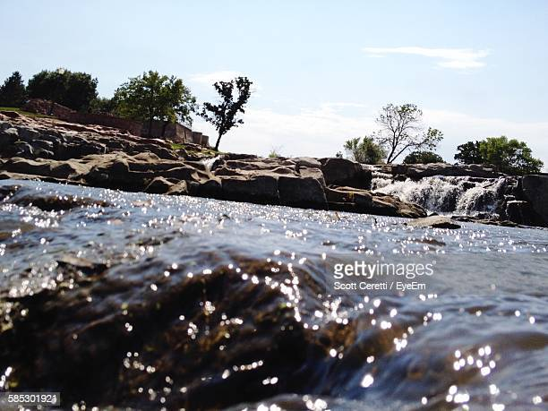 Close-Up Of Water Flowing Over Rocks At River