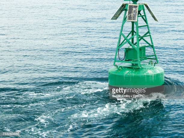 close-up of water in sea against sky - buoy stock photos and pictures