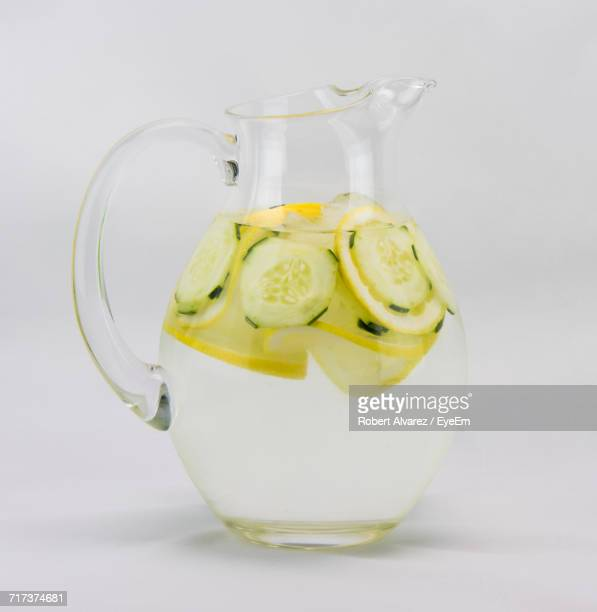 close-up of water jug over white background - pitcher stock pictures, royalty-free photos & images