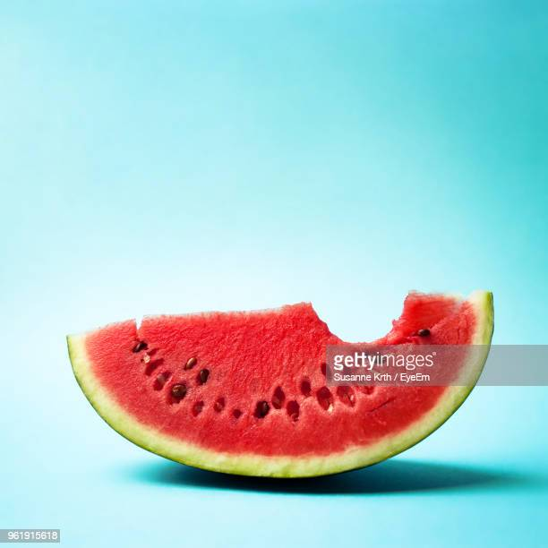 close-up of water melon slice against blue background - watermelon stock pictures, royalty-free photos & images