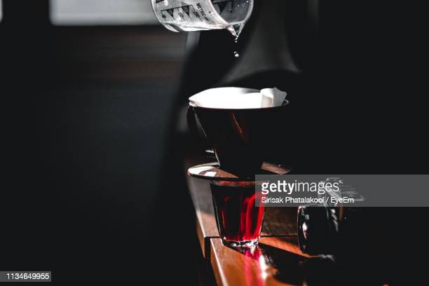 close-up of water pouring in coffee maker on wooden table - digital camera stock pictures, royalty-free photos & images