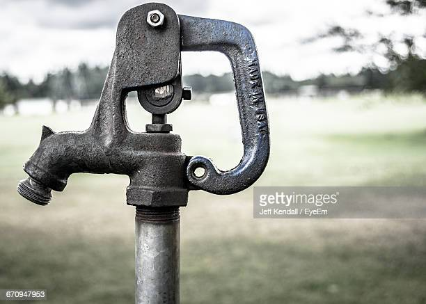 Close-Up Of Water Pump On Field