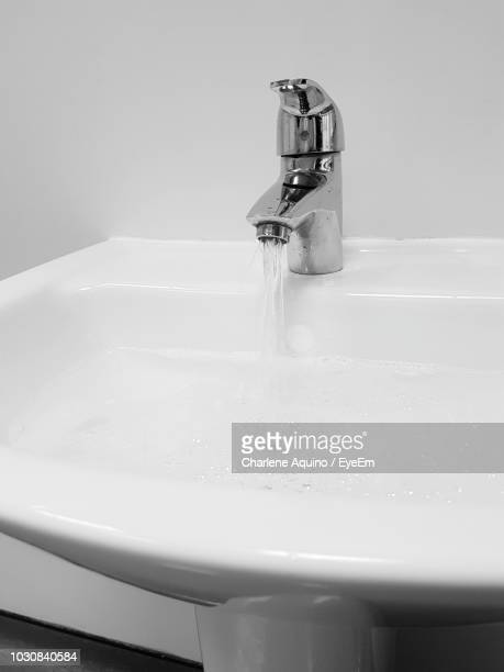 close-up of water running in sink - flowing water stock pictures, royalty-free photos & images