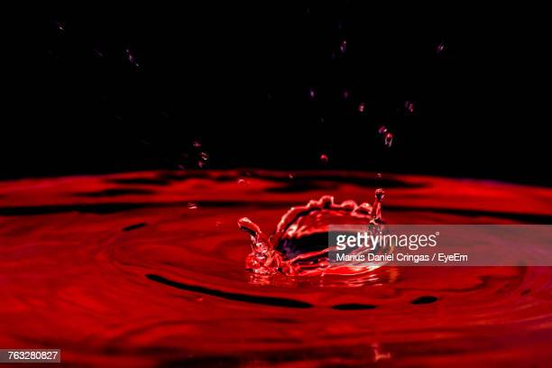close-up of water splashing against black background - crown close up stock pictures, royalty-free photos & images