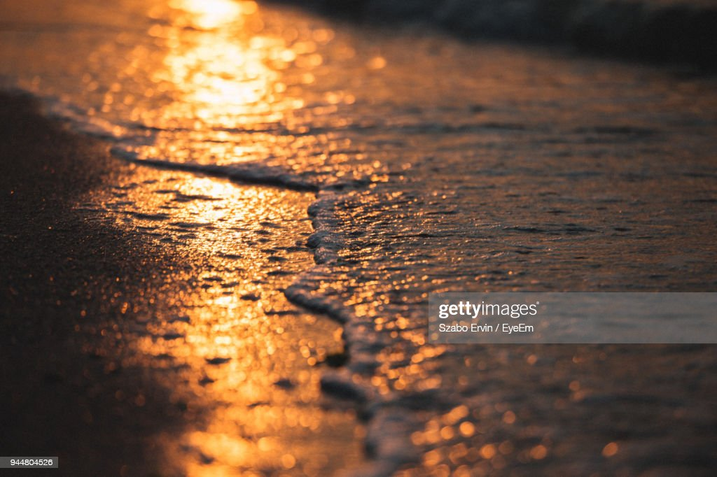 Close-Up Of Water Wave At Sunset : Stock Photo