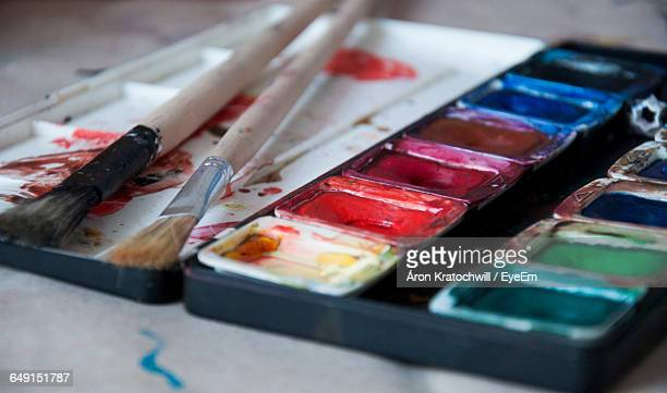Close-Up Of Watercolor Paints With Paintbrushes