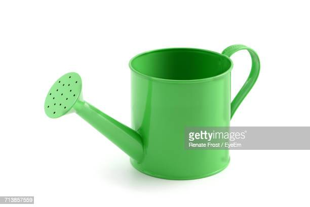 Close-Up Of Watering Can Against White Background