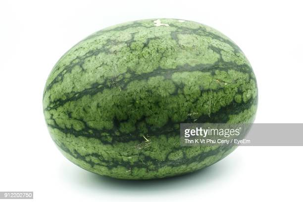 close-up of watermelon against white background - watermelon stock pictures, royalty-free photos & images