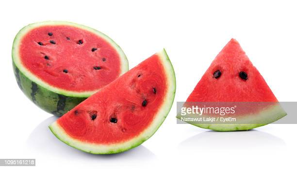 close-up of watermelon slice against white background - watermelon stock pictures, royalty-free photos & images