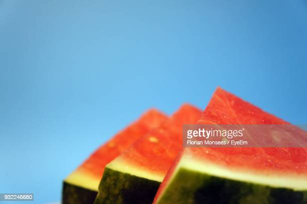 Close-Up Of Watermelon Slices Against Blue Background