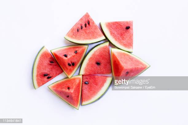 close-up of watermelon slices on white background - watermelon stock pictures, royalty-free photos & images