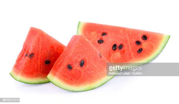close-up of watermelon slices over white background - watermelon stock pictures, royalty-free photos & images