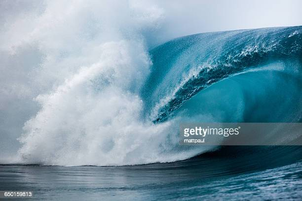 close-up of wave breaking over reef, tahiti, french polynesia - strength stock pictures, royalty-free photos & images