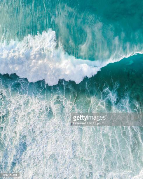 close-up of wave in sea against sky - aerial view stock-fotos und bilder