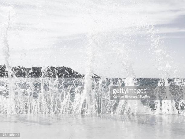 close-up of waves splashing in sea against sky - koper stock photos and pictures