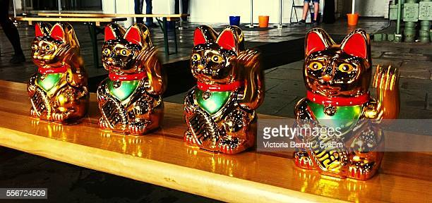 Close-Up Of Waving Cat Statues