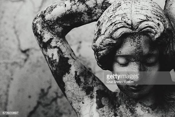 Close-Up Of Weathered Female Statue