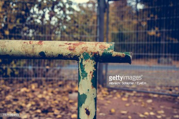 close-up of weathered rusty metallic pole against fence - albrecht schlotter stock pictures, royalty-free photos & images