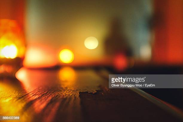 Close-Up Of Weathered Wood On Bar Counter In Illuminated Nightclub