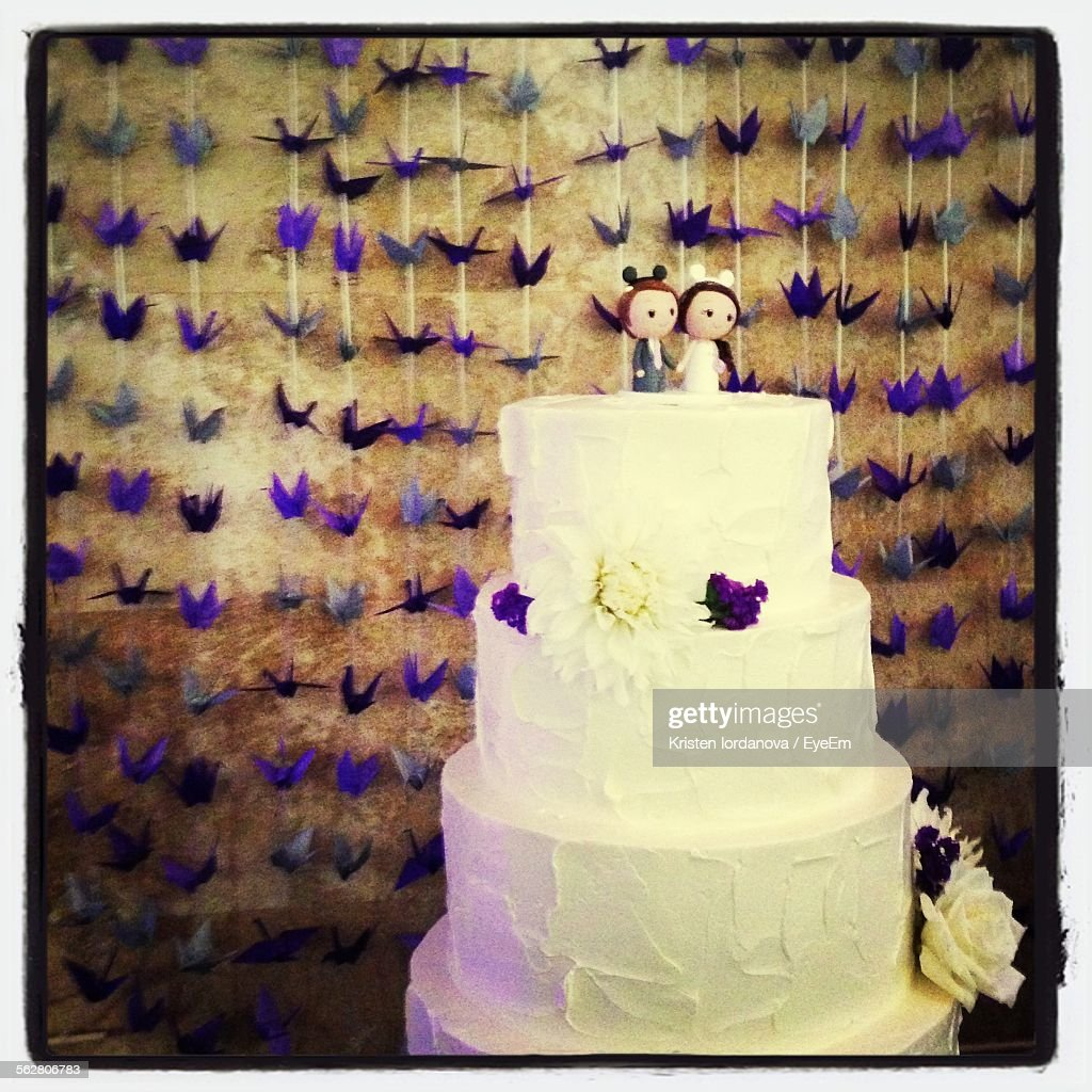 Closeup Of Wedding Cake Against Wall Stock Photo | Getty Images