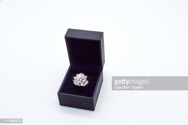 close-up of wedding in box over white background - 宝石箱 ストックフォトと画像