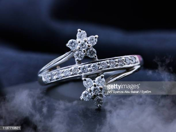close-up of wedding ring on table - platinum rings stock pictures, royalty-free photos & images