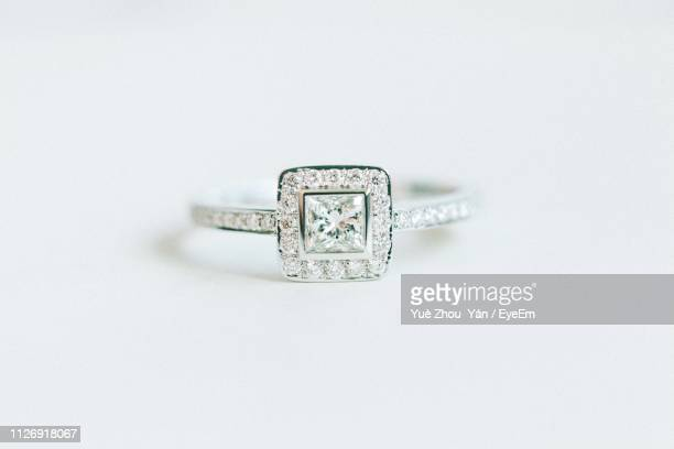 close-up of wedding ring on white background - diamond ring stock pictures, royalty-free photos & images
