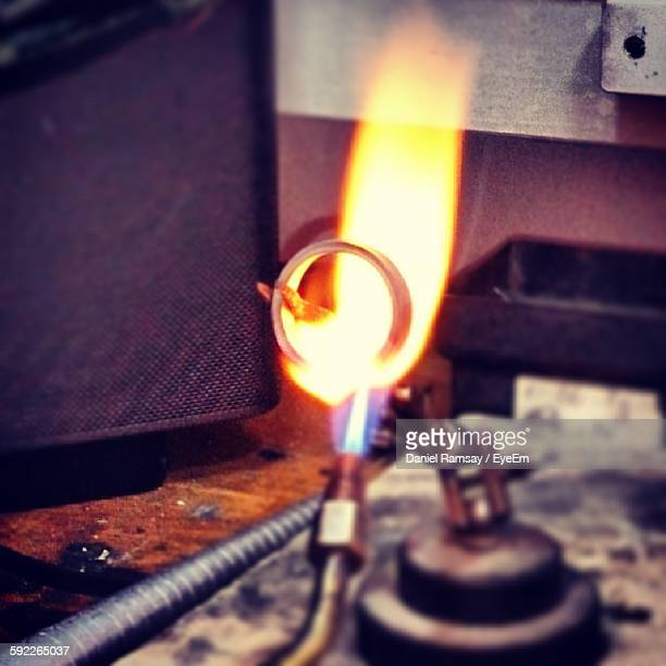 close-up of wedding ring under blow torch - platinum rings stock pictures, royalty-free photos & images
