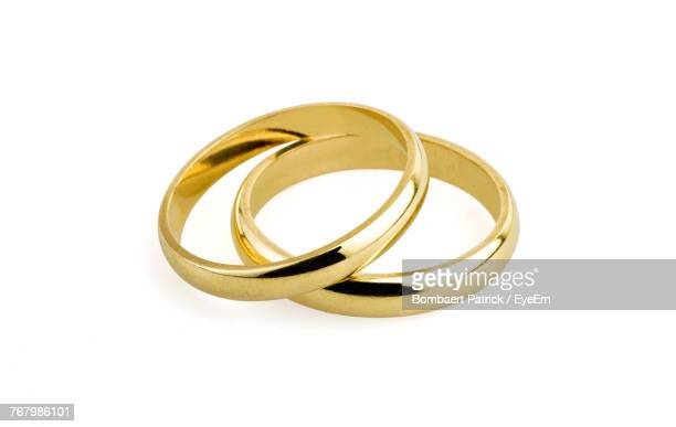 close-up of wedding rings against white background - wedding ring stock pictures, royalty-free photos & images