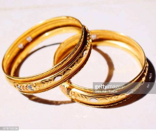 Close-Up Of Wedding Rings Against White Backgrounds