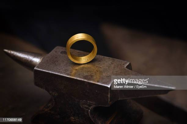 close-up of wedding rings anvil at table - ring stock pictures, royalty-free photos & images