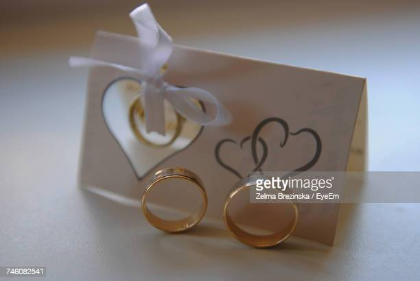 Close-Up Of Wedding Rings By Wedding Card