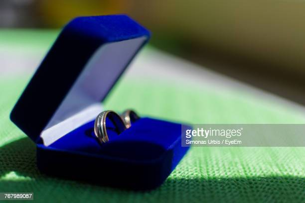 Close-Up Of Wedding Rings In Box On Table