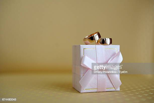 close-up of wedding rings on box - engagement ring box stock photos and pictures
