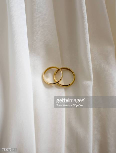 close-up of wedding rings on fabric - wedding ring stock pictures, royalty-free photos & images